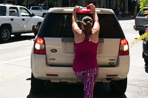 Insane Woman Blocks A Parking Spot With Her Body