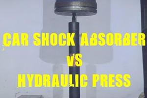 Shock Absorber Vs. 500-Ton Hydraulic Press Isn't A Very Fair Fight