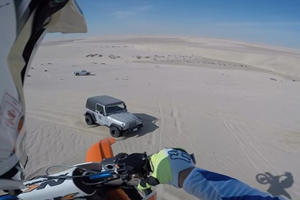 Dirt Biker Hits 100-Foot Jump Right Onto The Hood Of A Jeep Wrangler