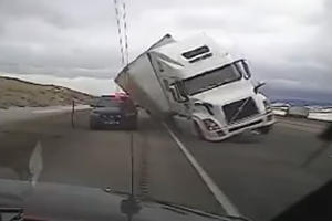 Watch Wind Cause A Truck To Tip Over And Crush A Cop Car