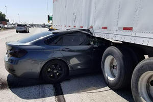 BMW Gets Pinned Under Semi Truck In Horrifying Hit And Run Crash