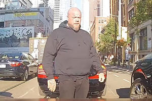 Watch Drake's Security Guard Stop Traffic For His Maybach