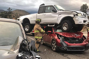 Pickup Truck Lands On Car In Crazy Crash – And Nobody Was Even Injured