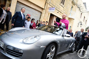 Priest Parades In Porsche Boxster Pulled By 50 Children