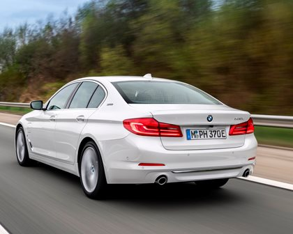 2018-2019 BMW 5 Series Plug-in Hybrid Rear Angle in Motion