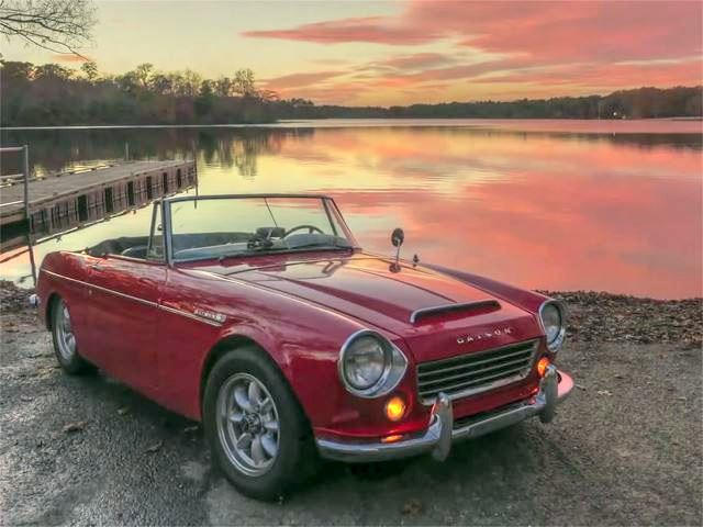 this guy is driving a 67 fairlady roadster cross country carbuzz rh carbuzz com 1963 Datsun Roadster Datsun 210