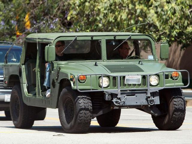 Arnold Schwarzenegger Shows Off World S First Electric Hummer H1