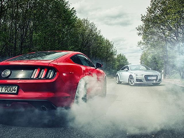 we ask: are today's top american muscle cars better than germany's
